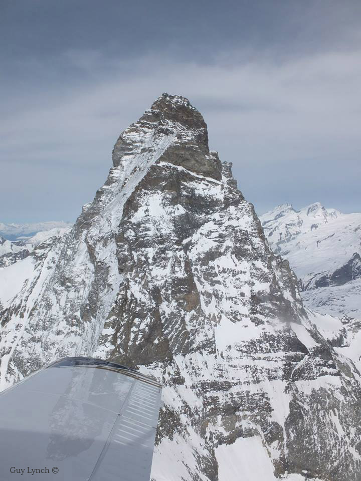 Plane wing in front of Matterhorn