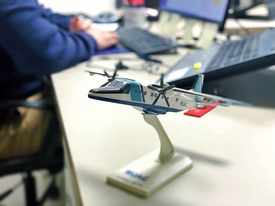 DMD Solutions plane on table